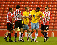 Photo. Glyn Thomas, Digitalsport<br /> NORWAY ONLY<br /> <br /> Sunderland v Crystal Palace. <br /> Division 1 Playoffs, second leg. 17/05/2004.<br /> Palace's Julian Gray (second from R) punches Sunderland's Carl Robinson (R) on his way back to the dressing room after being shown the red card.