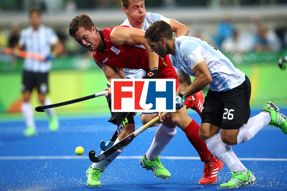 RIO DE JANEIRO, BRAZIL - AUGUST 18:  Tom Boon #27 of Belgium and Agustin Mazzilli #26 of Argentina compete during the Men's Hockey Gold Medal match between Belgium and Argentina on Day 13 of the Rio 2016 Olympic Games at Olympic Hockey Centre on August 18, 2016 in Rio de Janeiro, Brazil.  (Photo by Clive Brunskill/Getty Images)