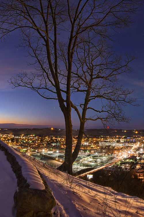 The glow of town is received by the snow laden hills at dusk as the stars come out to mark an end to the day.  Shot in Rotary Park, Huntington, West Virginia, three days after Winter Storm Jonas.