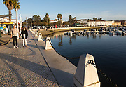 Activity around the marina area with people walking along the waterfront, Faro, Algarve, Portugal, Europe