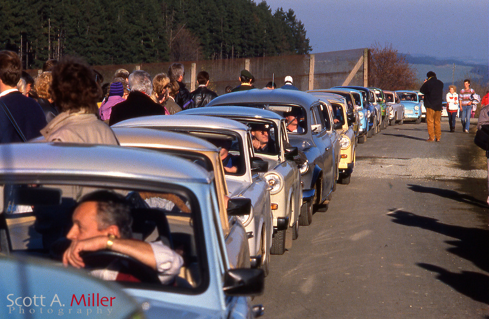 Lines of cars cross through a make-shift border crossing that was cut in a fence in the intra-German border near Hof, West Germany on Nov. 10, 1989. The borders between East and West Germany had been opened earlier for the first time in nearly 40 years...©1989 Scott A. Miller