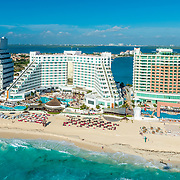 Aerial view of the ME Cancun and Beach Palace hotel.
