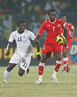 Photo: Steve Bond/Richard Lane Photography.<br />Ghana v Namibia. Africa Cup of Nations. 24/01/2008. Collin Benjamin (R) is closed down by Sulley Muntari (L)
