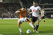 Hull midfielder Robert Snodgrass holds the ball up during the Sky Bet Championship match between Derby County and Hull City at the iPro Stadium, Derby, England on 5 April 2016. Photo by Aaron  Lupton.
