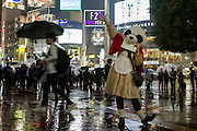 A woman dressed as a panda celebrates Halloween, despite the rain, Shibuya, Tokyo, Japan. Friday October 28th 2016 Halloween celebration in Japan have grown massively in the last few years. To ensure the safety of the crowds in Shibuya this year, the police closed several roads leading to the famous Hachiko Square, allowing costumed revellers to spread over a larger area.
