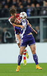 Arsenal's Mathieu Flamini challenges for the ball with Anderlecht's Dennis Praet - Photo mandatory by-line: Dougie Allward/JMP - Mobile: 07966 386802 - 22/10/2014 - SPORT - Football - Anderlecht - Constant Vanden Stockstadion - R.S.C. Anderlecht v Arsenal - UEFA Champions League - Group D