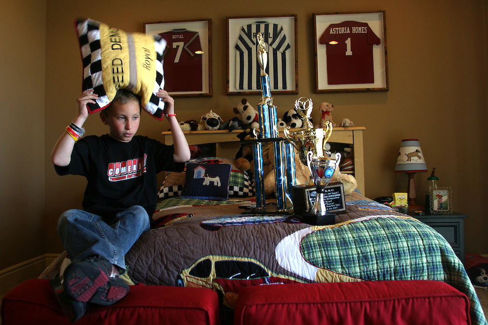 Royal  Mckee (7) in his room at Las Vegas Nevada with his trophies. Sunday March 04.2007