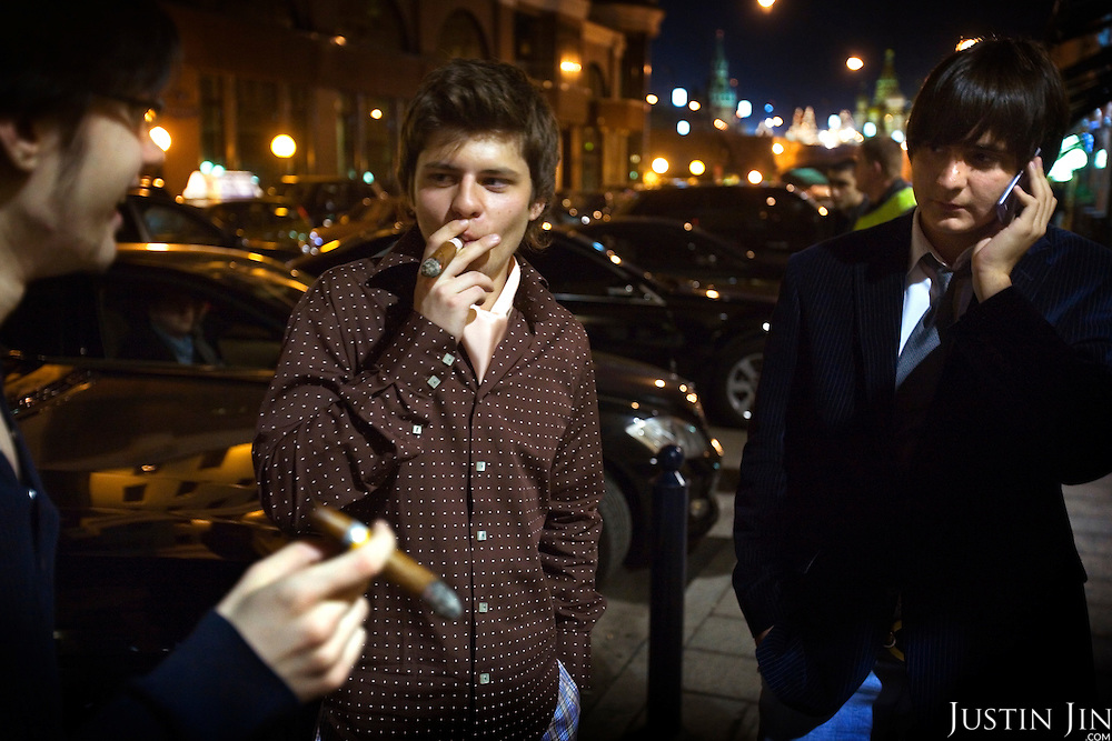 A group of wealthy youngsters smoke cigars at the GQ bar, one of Moscow's most expensive. Their fathers work for Russia's booming oil sector.