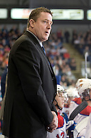 KELOWNA, CANADA, NOVEMBER 11: Derek Laxdal, head coach of the Edmonton OIl Kings, stands on the bench as the Edmonton OIl Kings visit the Kelowna Rockets  on November 11, 2011 at Prospera Place in Kelowna, British Columbia, Canada (Photo by Marissa Baecker/Shoot the Breeze) *** Local Caption ***Derek Laxdal;