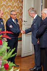 HRH Prince Philippe of Belgium receives the medalist from the Alltech FEI World Equestrian Games in Lexington  Kentucky 2010 at the Royal Palace in Brussels<br /> Speaking to  Ingmar Devos, General secretary of the Belgian Federation<br /> Also in the picture Mr Jacky Buchmann, president of the Belgian Federation, Philippe Lejeune.<br /> © Dirk Caremans