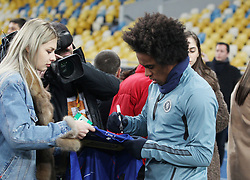 March 13, 2019 - Kiev, Ukraine - Chelsea WILLIAN gives a signature for fans, before a training session on the Olimpiyskiy stadium in Kiev, Ukraine, on 13 March 2019. Chelsea will face Dynamo Kyiv in the UEFA Europa League, second leg soccer match in Kiev on 14 March 2019. (Credit Image: © Serg Glovny/ZUMA Wire)