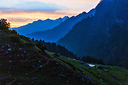 Sunset thought the layers of blue mountains at Kheerganga in Parvati valley in Kullu, Himachal Pradesh, India