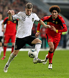 11.10.2011, Esprit Arena, Duesseldorf, GER, UEFA EURO 2012 Qualifikation, Deutschland (GER) vs Belgien (BEL), im Bild..Tino Kroos (GER) am Ball , dahinter Marouane Fellaini (Belgien)  ..// during the UEFA Euro 2012 qualifying round Germany vs Belgium  at Esprit Arena, Duesseldorf 2011-10-11 EXPA Pictures © 2011, PhotoCredit: EXPA/ nph/  Hessland       ****** out of GER / CRO  / BEL ******