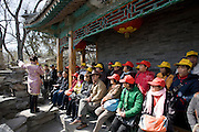 Tour guide with tourists at Prince Gong's Mansion, Hutongs Area, Beijing, China