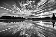 Reflection of clouds in Lac du Fou at sunrise<br />