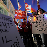 Supporters hold signs during a rally to show support for marriage equality Tuesday, March 26, 2013 in Tampa. Several hundred braved chili temperatures Tuesday night in support for marriage equality as the U.S. Supreme Court prepares to hear arguments in two cases that examine whether same-sex marriages should be recognized by the federal government.
