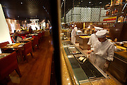 "Park Hyatt Hotel. The chefs of ""Square One"" fusion restaurant in their open kitchen."
