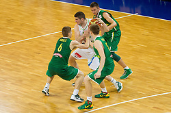 Marko Pajic of Slovenia between Evaldas Aniulis of Lithuania, Arnas Butkevicius of Lithuania and Edgaras Ulanovas of Lithuania during basketball match between National teams of Slovenia and Lithuania in First Round of U20 Men European Championship Slovenia 2012, on July 14, 2012 in Domzale, Slovenia.  (Photo by Vid Ponikvar / Sportida.com)