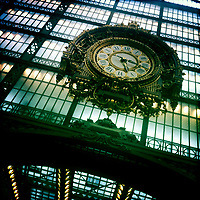 A steampunk Iron Clock on the glass fassade of Paris' Gare d'Orsay. Today the former Train Station is a Museum very much worth visiting for lovers of 19 and 20th Century Paintings.