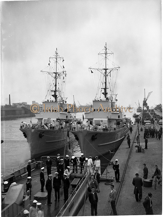 """27/07/1962<br /> 07/27/1962<br /> 27 July 1962<br /> German Naval ships visit Dublin. Three German Naval Minelayers the """"Hummel"""", """"Bremse"""" and """"Biene"""" arrived in Dublin on a five day visit. Image shows the """"Biene"""" F207 and """"Bremse"""" F208 with the deck of the """"Hummel"""" in the foreground at the South Wall, Dublin."""