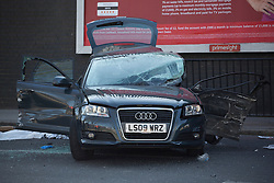 © licensed to London News Pictures. London, UK 29/03/2013. Two men died in a collision shortly before 2am on Friday 29 March on Seven Sisters Road in north London. Two male passengers in the Audi, both believed to be aged in their late 20s or early 30s, died in the collision. Photo credit: Tolga Akmen/LNP