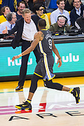 Golden State Warriors forward Andre Iguodala (9) celebrates a three pointer with Golden State Warriors head coach Steve Kerr against the San Antonio Spurs during Game 2 of the Western Conference Quarterfinals at Oracle Arena in Oakland, Calif., on April 16, 2018. (Stan Olszewski/Special to S.F. Examiner)