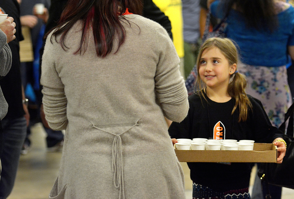 gbs032617h/ASEC -- Sofia Certain, 9, of Albuquerque passes out Villa Myriam Coffee samples at the Southwest Chocolate & Coffee Fest at the Expo NM State Fairgrounds on Sunday, March 26, 2017. Her father David Certain is the owner. (Greg Sorber/Albuquerque Journal)