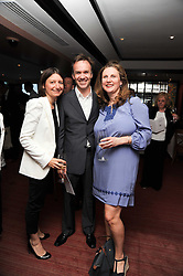 Left to right, JANE WAREING, chef MARCUS WAREING and ANGELA HARTNETT at a party to celebrate The Waterside Inn's 25 years as a 3 star Michelin restaurant held at The Waterside Inn, Bray, Berkshire on 18th May 2010.