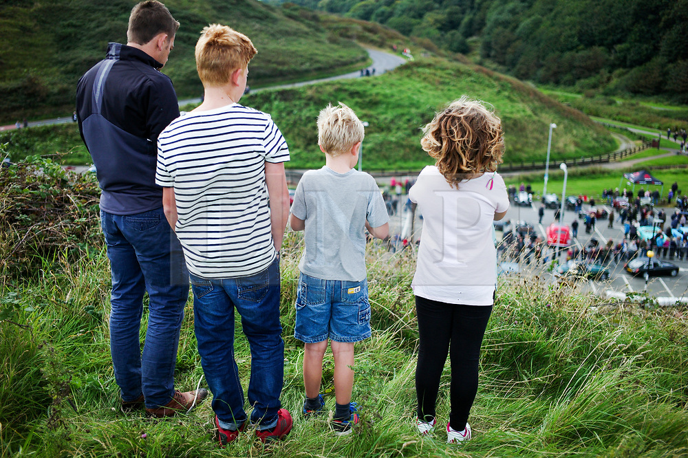 © Licensed to London News Pictures. <br /> 10/09/2017 <br /> Saltburn by the Sea, UK.  <br /> <br /> Spectators stand on a nearby hilltop and watch during the annual Saltburn by the Sea Historic Gathering and Hill Climb event. Organised by Middlesbrough and District Motor Club the event brings together owners of a wide range of classic cars and motorcycles dating from the early 1900's to 1975. Participants take part in a hill climb to test their machines up a steep hill near the town. Once held as a competitive gathering a change in road regulations forced the hill climb to become a non-competitive event.<br /> <br /> Photo credit: Ian Forsyth/LNP