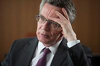 11 MAY 2015, BERLIN/GERMANY:<br /> Thomas de Maiziere, CDU, Bundesinnenminister, waehrend einem Interview, in seinem Buero, Bundesministerium des Inneren<br /> IMAGE: 20150511-01-021<br /> KEYWORDS: Thomas de Maizière