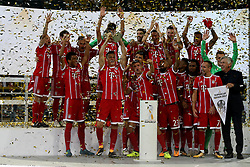 DORTMUND, Aug. 6, 2017  Team of Bayern Munich celebrate during the awarding ceremony after the 2017 German Super Cup match between Bayern Munich and Borussia Dortmund in Dortmund, Germany, on Aug. 5, 2017. Bayern Munich won 7-6 after penalty shootout and got the 2017 German Super Cup trophy. (Credit Image: © Joachim Bywaletz/Xinhua via ZUMA Wire)