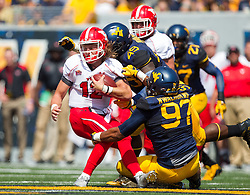 Sep 10, 2016; Morgantown, WV, USA; Youngstown State Penguins quarterback Ricky Davis (12) is tackled by West Virginia Mountaineers defensive lineman Darrien Howard (49) and West Virginia Mountaineers defensive lineman Noble Nwachukwu (97) during the first quarter at Milan Puskar Stadium. Mandatory Credit: Ben Queen-USA TODAY Sports