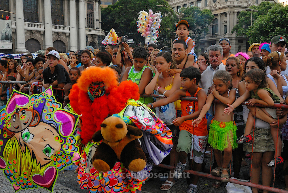 "Great competition for the best ""Bate Bola"" costume in the center of Rio de Janeiro. Some gangs carry their ""hit-the-ball"", when others prefered a soft toy or an umbrella as a sign of pacifism. The costume can coast until 600 USD$ to prepare, representing more than the minimum salary in Brazil.."