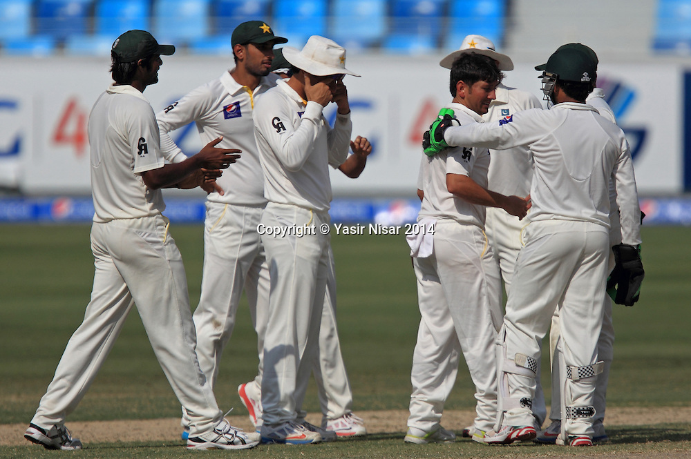 Pakistan vs New Zealand, 21 November 2014 <br /> Pakistani players celebrate Yasir Shah on taking his 5th wicket on the fifth day of second test in Dubai