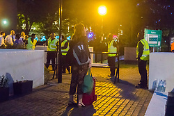 London, June 23rd 2017. Residents of Chalcot Estate, a complex of five tower blocks, are evacuated over concerns that the cladding used in a refurbishment is the same as that used in the Grenfell Tower Fire disaster that's so far claimed 79 lives.The cladding from all five towers will be removed over the next few weeks. PICTURED: With the basic necessities packed in a suitcase, a woman contemplates her next steps.