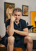 Alberto Godoy, Cuban painter, photographed in his Houston, TX gallery studio.<br /> Photographed by commercial photographer Nathan Lindstrom.