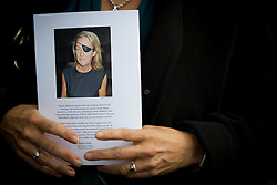 © Licensed to London News Pictures. 16/05/2012. London, UK. A guest holding a service book leaving St Martin in the Fields church, London following a memorial service held for American Sunday Times journalist Marie Colvin, who died covering the siege of Homs in Syria.  Photo credit : Ben Cawthra/LNP