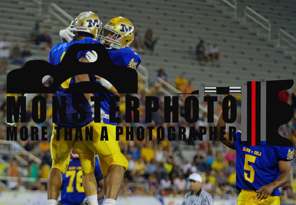 Blue cornerback Andre Patton (8) of Saint Elizabeth High School celebrates with teammate Jesse June (1) of the Salesianum School after Patton scored a touchdown in the fourth-quarter of the 58th Annual DFRC Blue-Gold All-Star Football game Saturday, June. 22, 2013, at Delaware Stadium in Newark DE.