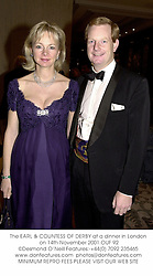 The EARL & COUNTESS OF DERBY at a dinner in London on 14th November 2001.	OUF 92