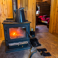 Wood stove in the Bridge Cabin at Bowlin Camps near Patten, Maine, and Katahdin Woods and Waters National Monument.