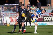 6th October 2018, Dens Park, Dundee, Scotland; Ladbrokes Premiership football, Dundee versus Kilmarnock; Lewis Spence of Dundee challenges for the ball with Alan Power of Kilmarnock