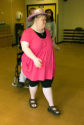 Day Service users with learning disability taking part in line dancing class,