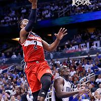 28 October 2015: Washington Wizards guard John Wall (2) goes for the layup over Orlando Magic guard Victor Oladipo (5) during the Washington Wizards 88-87 victory over the Orlando Magic, at the Amway Center, in Orlando, Florida, USA.
