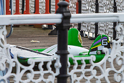 © Licensed to London News Pictures. 09/04/2019. Brighton, UK. A damaged part of the ride lies on the floor alongside the Air Race after an accident closed the attraction on Brghton Pier. Photo credit: Hugo Michiels/LNP