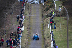© Licensed to London News Pictures. 28/01/2018. Weybridge, UK. Driver Paul Compton steers his 1934 Wolseley Aerees Special up the steep gradient on the hill test at Brooklands Museum during The Vintage Sports-Car Club's New Year driving tests.  Photo credit: Peter Macdiarmid/LNP