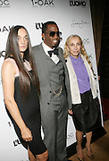 "l to r: Rustsk Bergman, Sean "" Diddy "" Combs and Franca Sozzani pictured at the cocktail party celebrating Sean ""Diddy"" Combs appearance on the "" Black on Black "" cover of L'Uomo Vogue's October Music Issue"