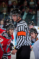 KELOWNA, CANADA - OCTOBER 4:   Nick Swaine, referee stands at centre ice at the Kelowna Rockets on October 4, 2013 at Prospera Place in Kelowna, British Columbia, Canada (Photo by Marissa Baecker/Shoot the Breeze) *** Local Caption ***