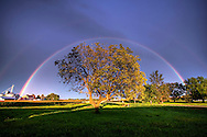 After a nasty thunderstorm had passed, the sun peaks out to create two rainbows over the rural countryside in German Valley, IL.
