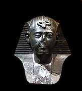 Statue of Seti I. 19th Dynasty 1283 - 1278 BC. Black Granite. Shows Seti I kneeling in dedication to Osiris; from the Temple of Abydos