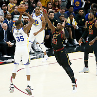 CLEVELAND, OH - JUN 3: Kevin Durant #35 of the Golden State Warriors takes a jump shot over Jeff Green #32 of the Cleveland Cavaliers in Game Three of the 2018 NBA Finals won 110-102 by the Golden State Warriors over the Cleveland Cavaliers at the Quicken Loans Arena on June 6, 2018 in Cleveland, Ohio. NOTE TO USER: User expressly acknowledges and agrees that, by downloading and or using this photograph, User is consenting to the terms and conditions of the Getty Images License Agreement. Mandatory Copyright Notice: Copyright 2018 NBAE (Photo by Chris Elise/NBAE via Getty Images)